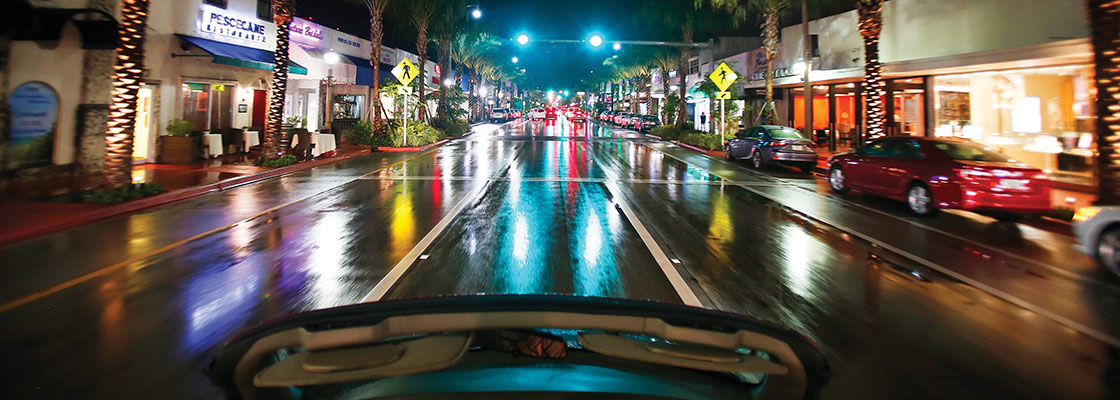 Car driving down Harding avenue at night - photo courtesy of Jacober Creative